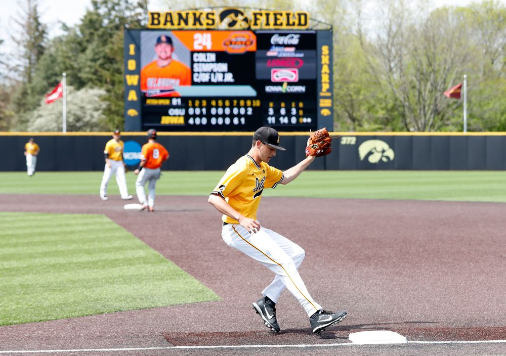Iowa Hawkeyes pitcher Nick Nelsen (12) gets the final out against the Oklahoma State Cowboys Sunday, May 6, 2018 at Duane Banks Field. (Brian Ray/hawkeyesports.com)