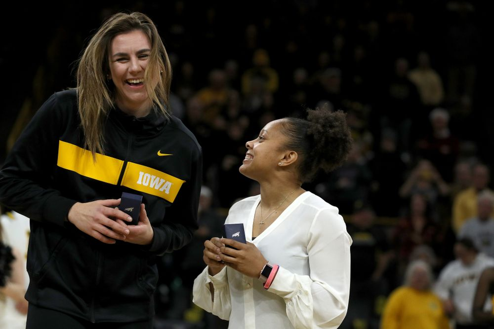 Former Hawkeye and Clemson graduate assistant Tania Davis and former Hawkeye Hannah Stewart react after receiving their against Big Ten Tournament championship rings before the Hawkeye game against Clemson Wednesday, December 4, 2019 at Carver-Hawkeye Arena. (Brian Ray/hawkeyesports.com)
