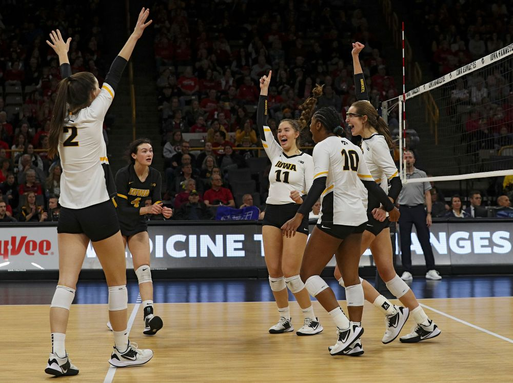 Iowa's Courtney Buzzerio (2), Halle Johnston (4), Blythe Rients (11), Griere Hughes (10), and Grace Tubbs (16) celebrate a score during the second set of their match against Nebraska at Carver-Hawkeye Arena in Iowa City on Saturday, Nov 9, 2019. (Stephen Mally/hawkeyesports.com)