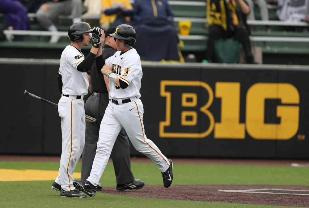 Iowa Hawkeyes catcher Austin Martin (34) and outfielder Ben Norman (9) against Michigan State Sunday, May 12, 2019 at Duane Banks Field. (Brian Ray/hawkeyesports.com)