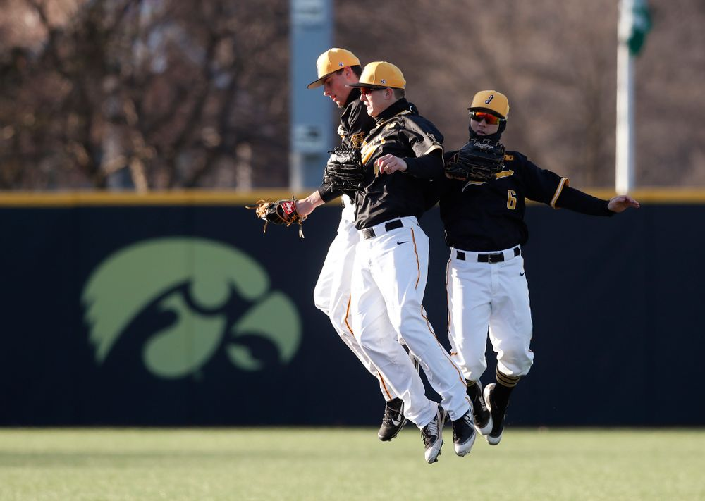 Iowa Hawkeyes outfielder Ben Norman (9), outfielder Robert Neustrom (44), and outfielder Justin Jenkins (6) against Grand View Wednesday, April 4, 2018 at Duane Banks Field. (Brian Ray/hawkeyesports.com)