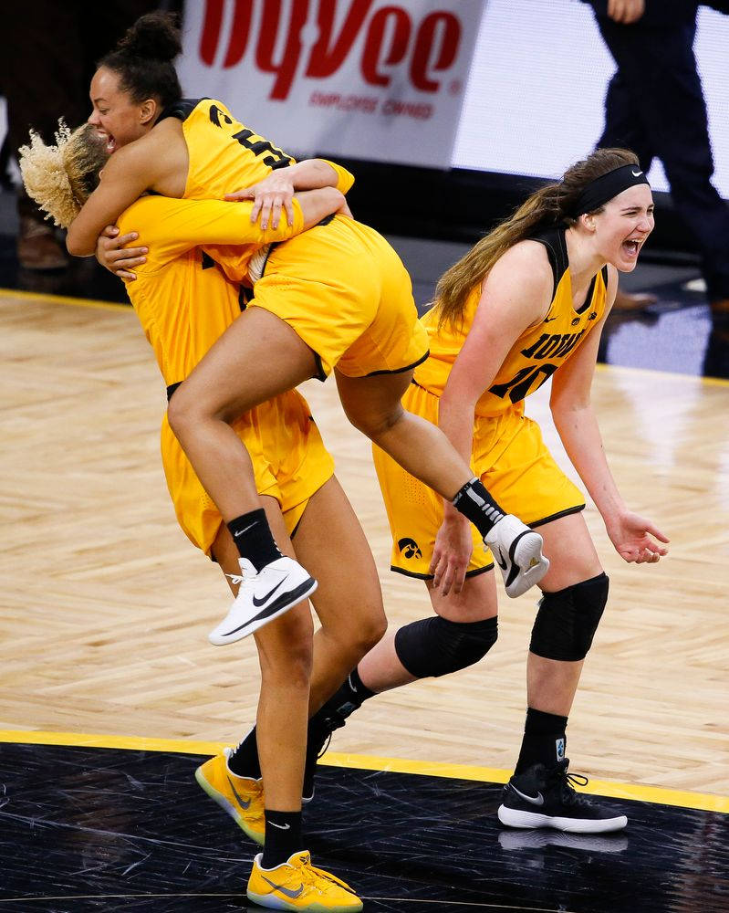 Iowa Hawkeyes forward Chase Coley (4), Iowa Hawkeyes guard Alexis Sevillian (5) and Iowa Hawkeyes forward Megan Gustafson (10) celebrate after beating the Ohio State Buckeyes, 103-89, at Carver-Hawkeye Arena on January 25, 2018. (Tork Mason/hawkeyesports.com)