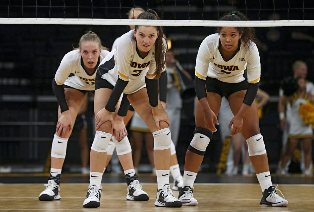 Iowa's Hannah Clayton (18), Courtney Buzzerio (2), and Brie Orr (7) wait for a serve during the third set of their Big Ten/Pac-12 Challenge match against Colorado at Carver-Hawkeye Arena in Iowa City on Friday, Sep 6, 2019. (Stephen Mally/hawkeyesports.com)