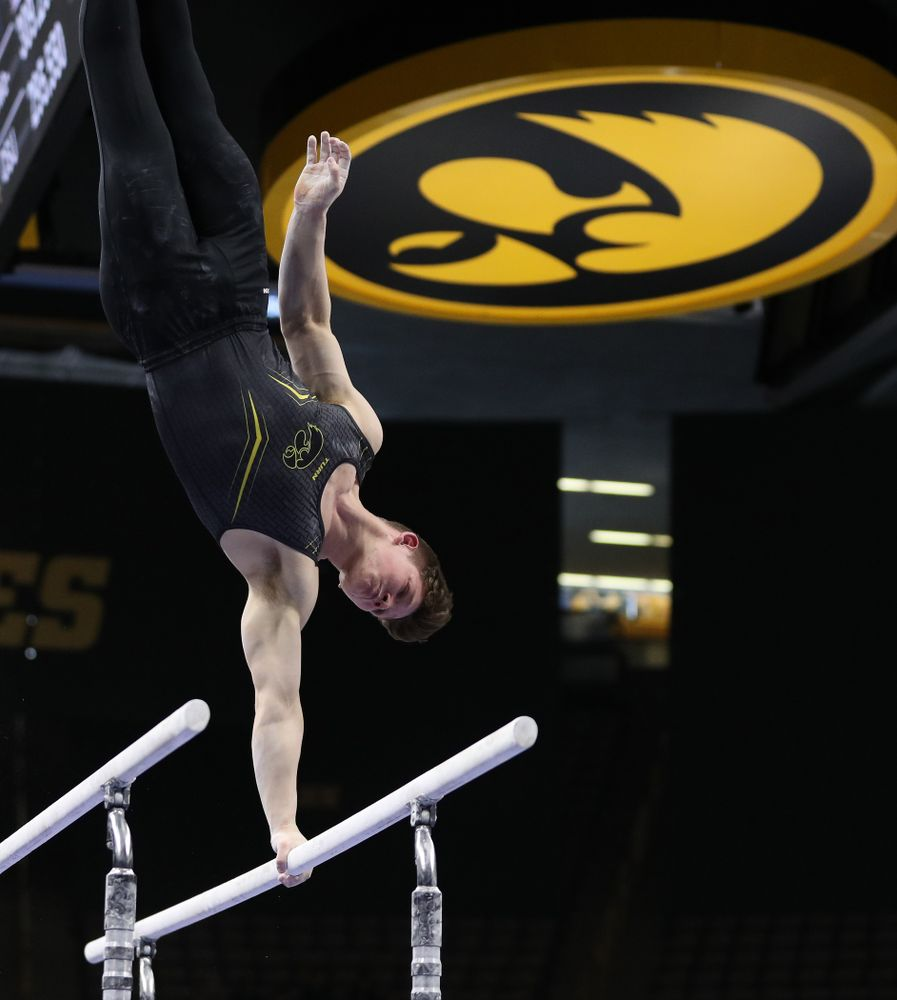 Iowa's Stewart Brown competes on the parallel bars against the Ohio State Buckeyes  Saturday, March 16, 2019 at Carver-Hawkeye Arena.  (Brian Ray/hawkeyesports.com)