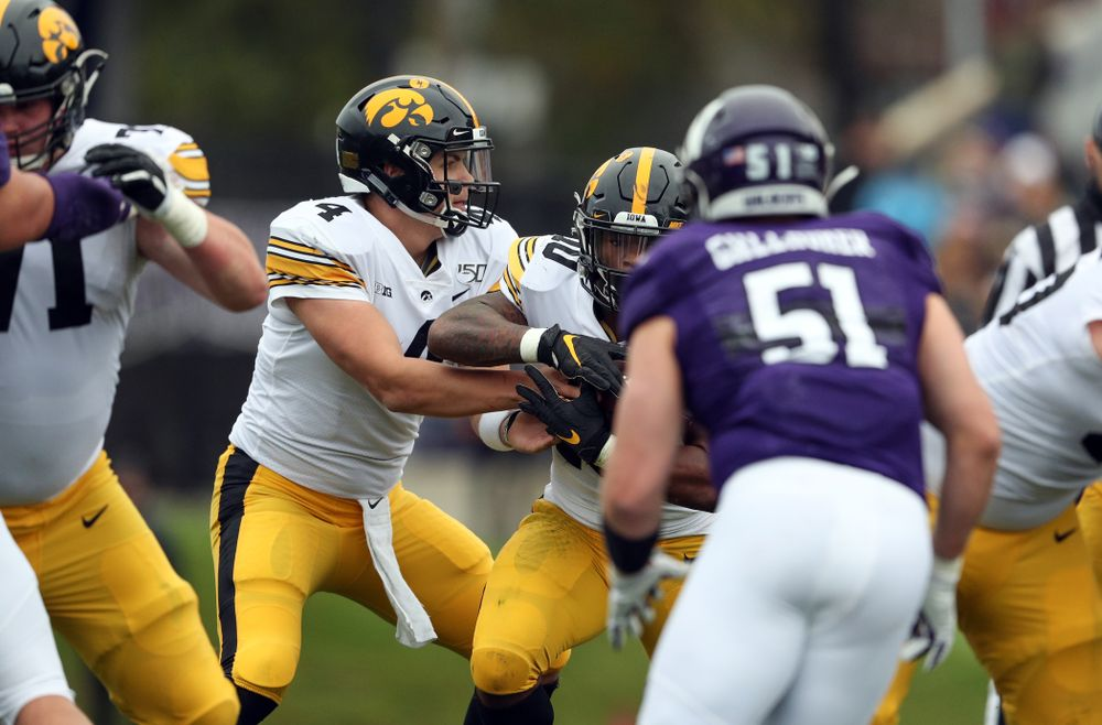 Iowa Hawkeyes quarterback Nate Stanley (4) and running back Mekhi Sargent (10) against the Northwestern Wildcats Saturday, October 26, 2019 at Ryan Field in Evanston, Ill. (Brian Ray/hawkeyesports.com)