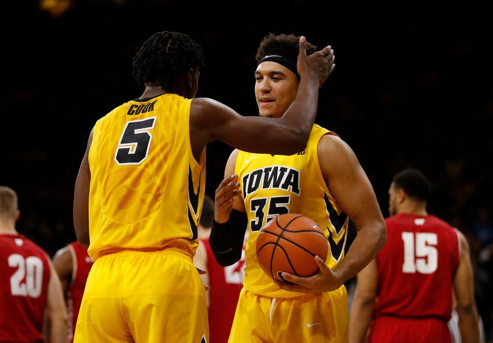 Iowa Hawkeyes forward Tyler Cook (5) and forward Cordell Pemsl (35)