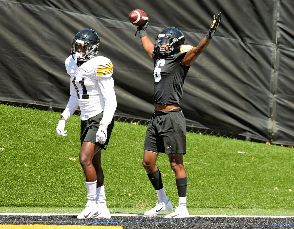 Iowa Hawkeyes wide receiver Ihmir Smith-Marsette (6) celebrates after pulling in a touchdown around defensive back Michael Ojemudia (11) during Fall Camp Practice No. 7 at the Hansen Football Performance Center in Iowa City on Friday, Aug 9, 2019. (Stephen Mally/hawkeyesports.com)