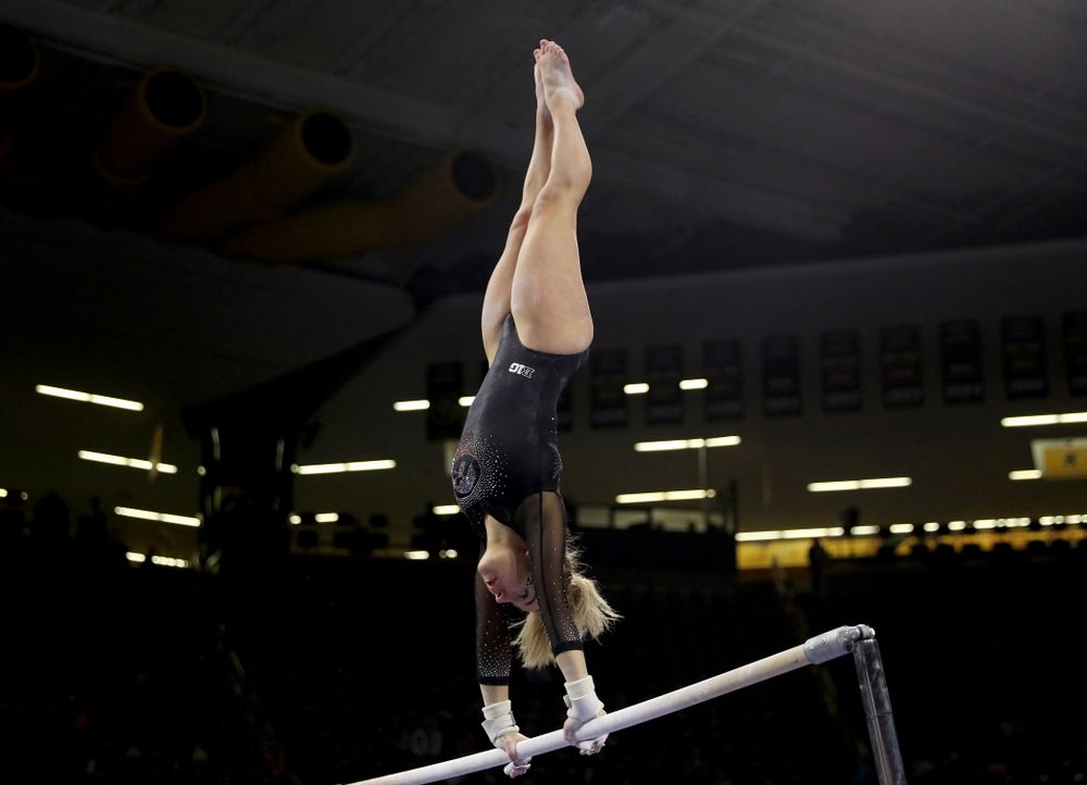 Iowa's Alex Greenwald competes on the bars against Michigan Friday, February 14, 2020 at Carver-Hawkeye Arena. (Brian Ray/hawkeyesports.com)