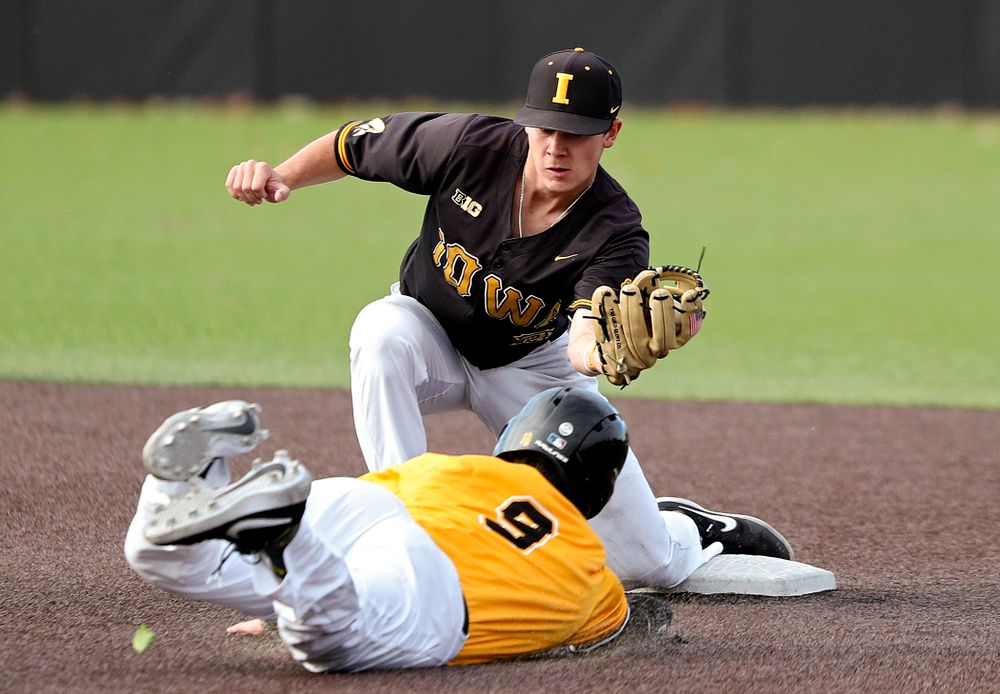 Iowa's Sam Link (3) tags out outfielder Ben Norman (9) as he tries to steal second base during the second inning of the first game of the Black and Gold Fall World Series at Duane Banks Field in Iowa City on Tuesday, Oct 15, 2019. (Stephen Mally/hawkeyesports.com)