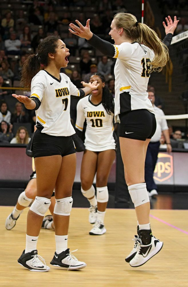 Iowa's Brie Orr (7) and Hannah Clayton (18) celebrate a score during the fourth set of their volleyball match at Carver-Hawkeye Arena in Iowa City on Sunday, Oct 13, 2019. (Stephen Mally/hawkeyesports.com)