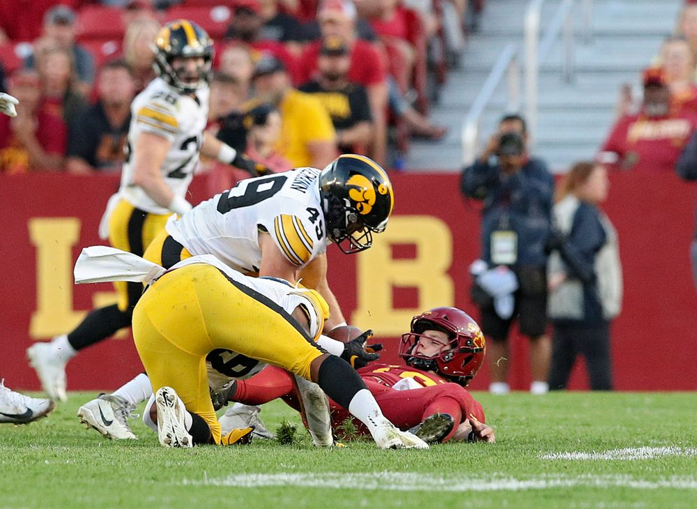 Iowa Hawkeyes linebacker Nick Niemann (49) tries to grab an Iowa State fumble during the second quarter of their Iowa Corn Cy-Hawk Series game at Jack Trice Stadium in Ames on Saturday, Sep 14, 2019. (Stephen Mally/hawkeyesports.com)