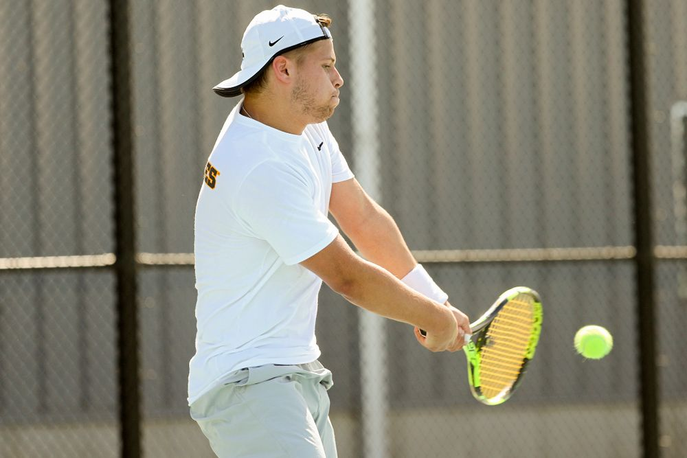 Iowa's Will Davies during his match against Michigan at the Hawkeye Tennis and Recreation Complex in Iowa City on Sunday, Apr. 21, 2019. (Stephen Mally/hawkeyesports.com)