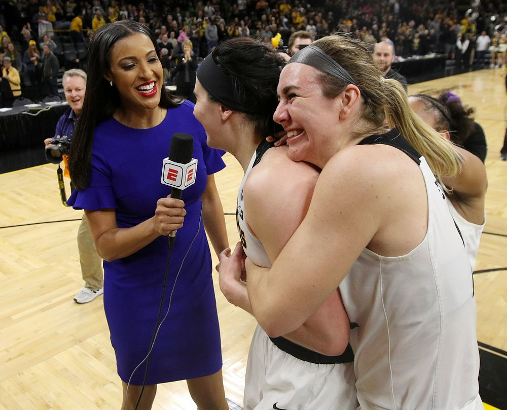 Iowa Hawkeyes center Megan Gustafson (10) is hugged by guard Tania Davis (11) and forward Hannah Stewart (21) as she is interviewed by ESPN's Christy Winters Scott after winning their second round game in the 2019 NCAA Women's Basketball Tournament at Carver Hawkeye Arena in Iowa City on Sunday, Mar. 24, 2019. (Stephen Mally for hawkeyesports.com)