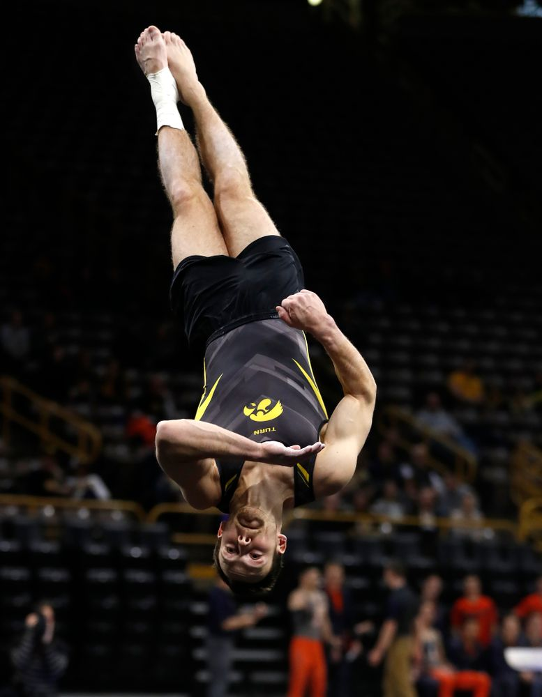 Dylan Ellsworth competes on the floor against Illinois