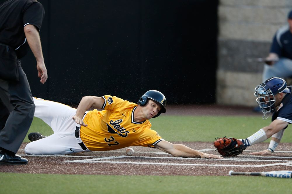 Iowa Hawkeyes outfielder Kace Massner (37) slides into home against the Penn State Nittany Lions Saturday, May 19, 2018 at Duane Banks Field. (Brian Ray/hawkeyesports.com)