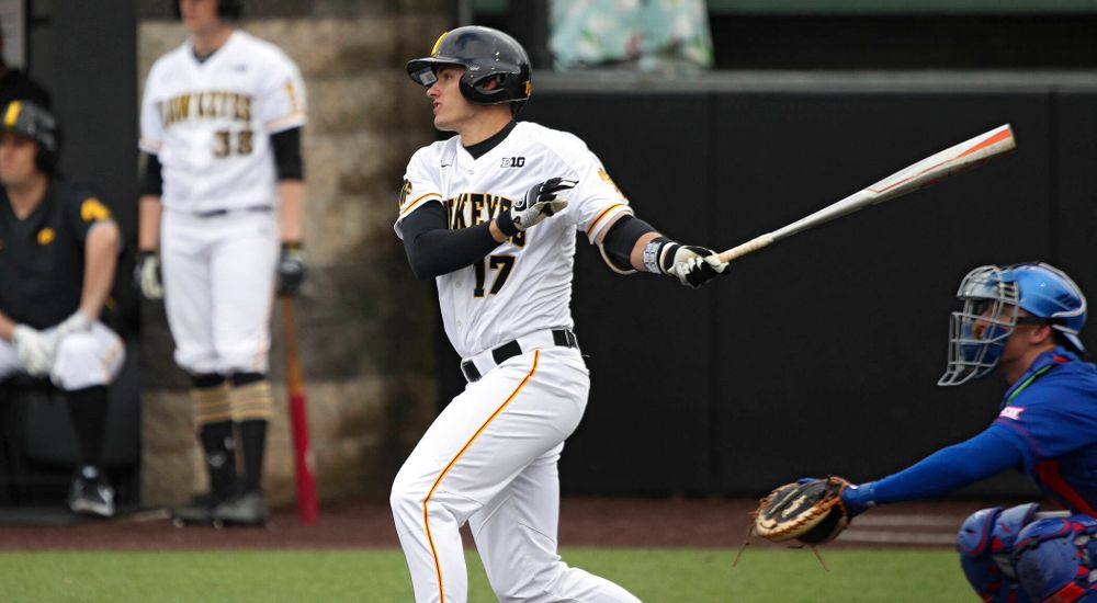 Iowa shortstop Dylan Nedved (17) hits an RBI double during the fourth inning of their college baseball game at Duane Banks Field in Iowa City on Wednesday, March 11, 2020. (Stephen Mally/hawkeyesports.com)