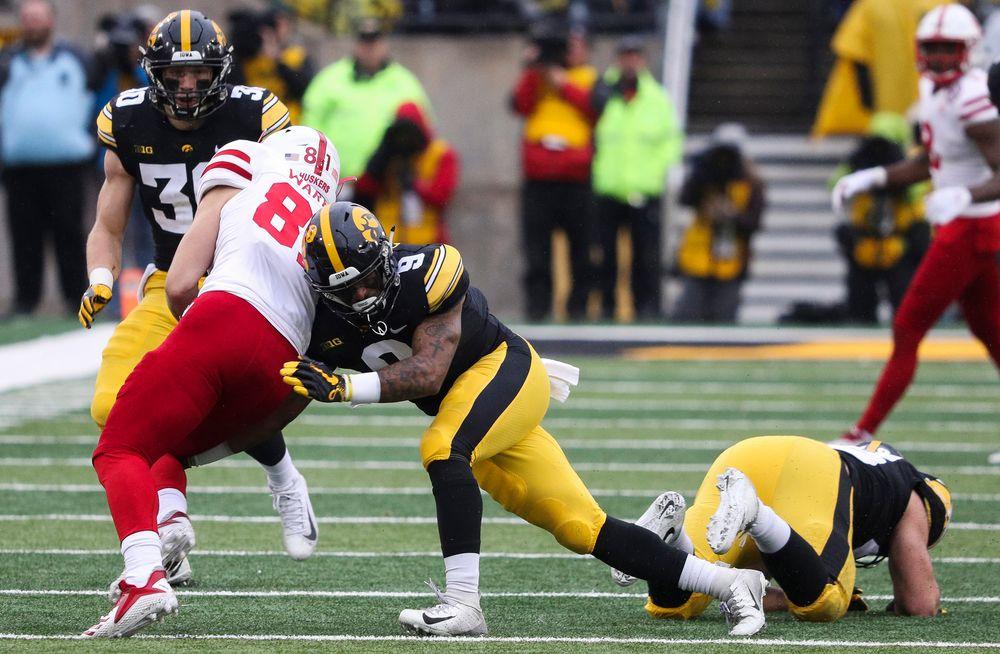 Iowa Hawkeyes defensive back Geno Stone (9) makes a tackle during a game against Nebraska at Kinnick Stadium on November 23, 2018. (Tork Mason/hawkeyesports.com)