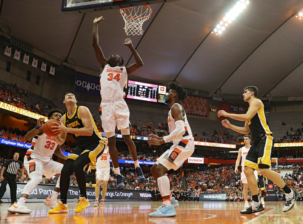 Iowa Hawkeyes forward Ryan Kriener (15) waits for Syracuse Orange forward Bourama Sidibe (34) to clear before making a basket during the first half of their ACC/Big Ten Challenge game at the Carrier Dome in Syracuse, N.Y. on Tuesday, Dec 3, 2019. (Stephen Mally/hawkeyesports.com)