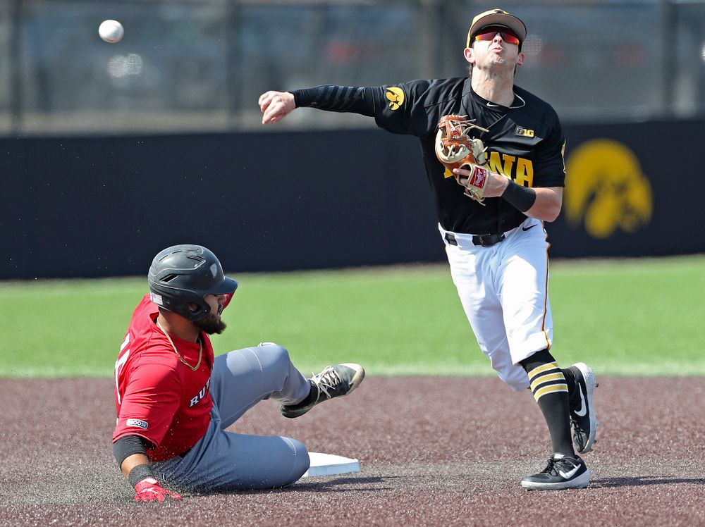 Iowa Hawkeyes second baseman Mitchell Boe (4) throws to first during the first inning of their game against Rutgers at Duane Banks Field in Iowa City on Saturday, Apr. 6, 2019. (Stephen Mally/hawkeyesports.com)