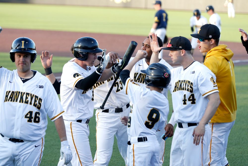 Iowa Hawkeyes infielder Matt Hoeg (3) celebrates with his teammates after scoring against the Michigan Wolverines Friday, April 27, 2018 at Duane Banks Field in Iowa City. (Brian Ray/hawkeyesports.com)