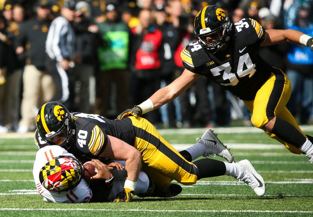 Iowa Hawkeyes defensive end Parker Hesse (40) sacks the quarterback during a game against Maryland at Kinnick Stadium on October 20, 2018. (Tork Mason/hawkeyesports.com)