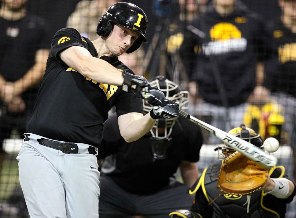 Iowa Hawkeyes pitcher/outfielder Trenton Wallace (38) bats during practice at the Hansen Football Performance Center in Iowa City on Friday, January 24, 2020. (Stephen Mally/hawkeyesports.com)