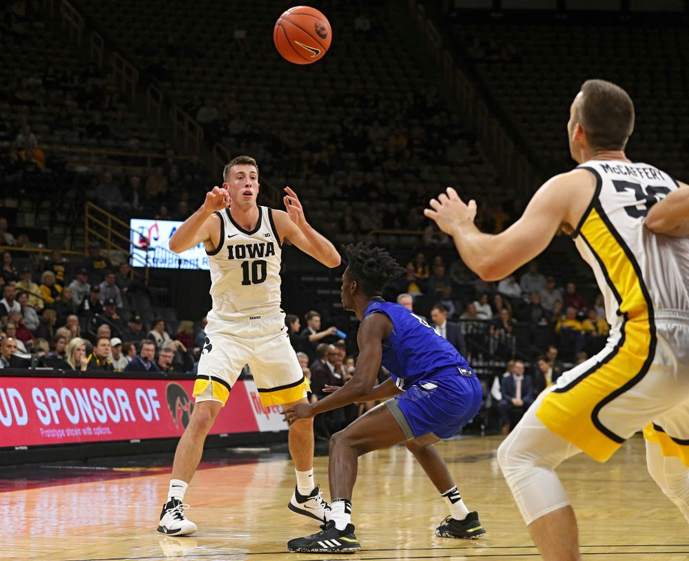 Iowa Hawkeyes guard Joe Wieskamp (10) passes the ball to guard Connor McCaffery (30) during the first half of their exhibition game against Lindsey Wilson College at Carver-Hawkeye Arena in Iowa City on Monday, Nov 4, 2019. (Stephen Mally/hawkeyesports.com)