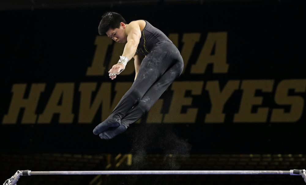 Iowa's Bennet Huang competes in the horizontal bar during the first day of the Big Ten Men's Gymnastics Championships at Carver-Hawkeye Arena in Iowa City on Friday, Apr. 5, 2019. (Stephen Mally/hawkeyesports.com)