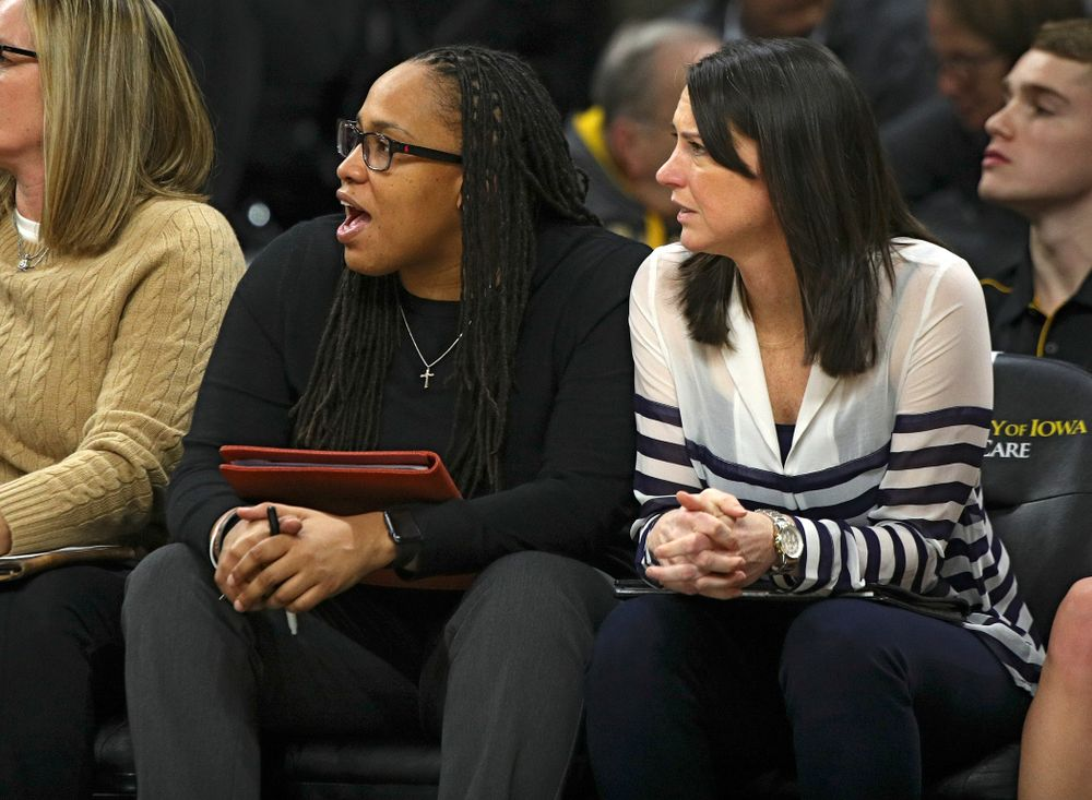 Iowa assistant coach Raina Harmon (from left) talks with assistant coach Abby Stamp during the fourth quarter of the game at Carver-Hawkeye Arena in Iowa City on Thursday, February 6, 2020. (Stephen Mally/hawkeyesports.com)