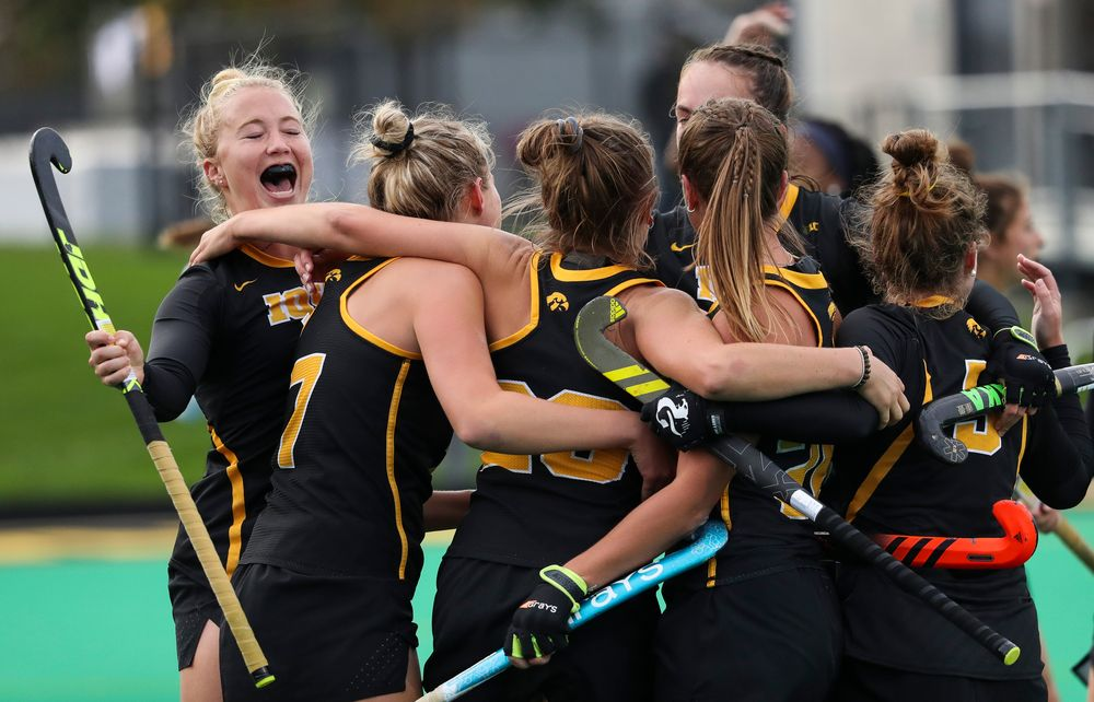 Members of the Iowa Hawkeyes field hockey team celebrate after a goal scored by Iowa Hawkeyes forward Madeleine Murphy (26) during a game against No. 6 Penn State at Grant Field on October 12, 2018. (Tork Mason/hawkeyesports.com)
