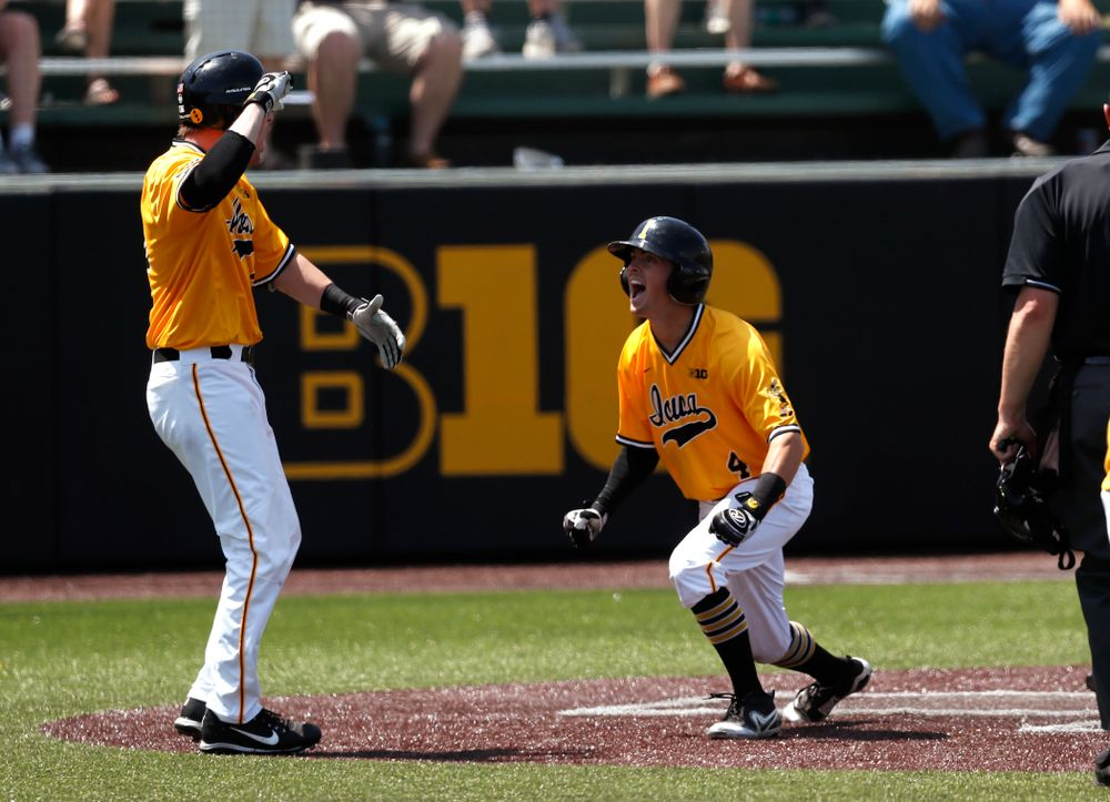 Iowa Hawkeyes infielder Mitchell Boe (4) hits an inside the park home run against the Oklahoma State Cowboys Sunday, May 6, 2018 at Duane Banks Field. (Brian Ray/hawkeyesports.com)