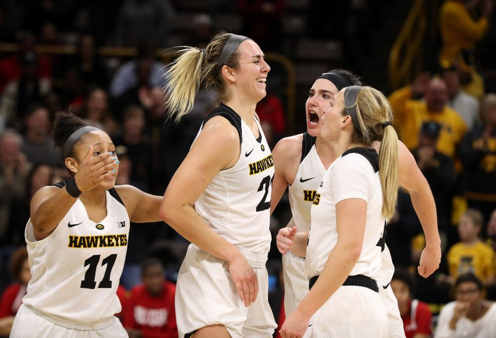 Iowa Hawkeyes forward Hannah Stewart (21) celebrates with forward Megan Gustafson (10), guard Tania Davis (11), and guard Makenzie Meyer (3)  after getting a block and a steal late in the game against the Rutgers Scarlet Knights Wednesday, January 23, 2019 at Carver-Hawkeye Arena. (Brian Ray/hawkeyesports.com)
