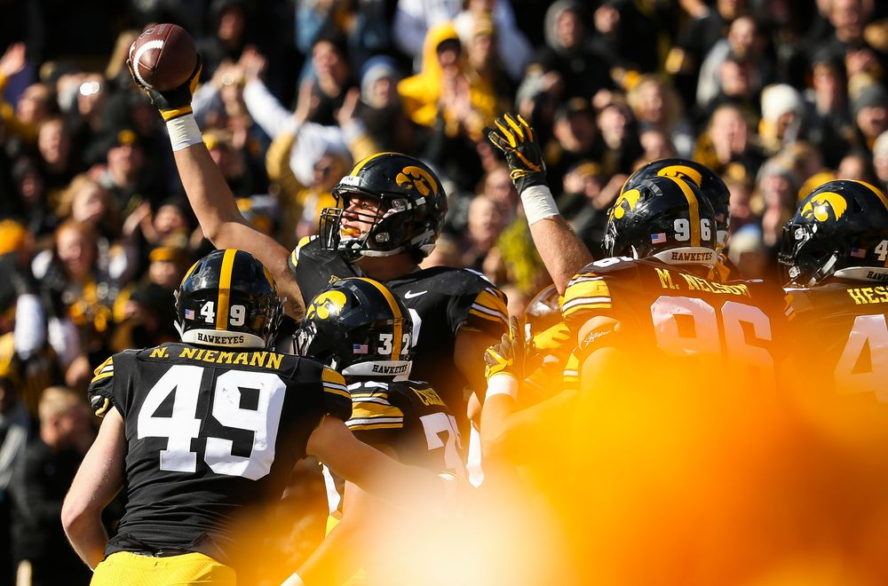 Iowa Hawkeyes defensive end Anthony Nelson (98) celebrates after scoring a touchdown during a game against Maryland at Kinnick Stadium on October 20, 2018. (Tork Mason/hawkeyesports.com)