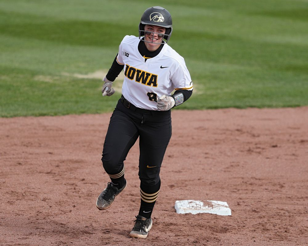 Iowa catcher Abby Lien (9) rounds the bases after hitting a home run during the second inning of their game against Illinois at Pearl Field in Iowa City on Friday, Apr. 12, 2019. (Stephen Mally/hawkeyesports.com)