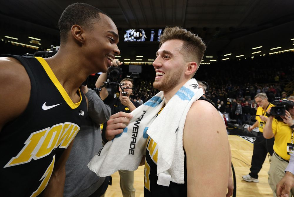 Iowa Hawkeyes guard Jordan Bohannon (3) celebrates with guard Maishe Dailey (1) after defeating the Indiana Hoosiers in overtime Friday, February 22, 2019 at Carver-Hawkeye Arena. (Brian Ray/hawkeyesports.com)