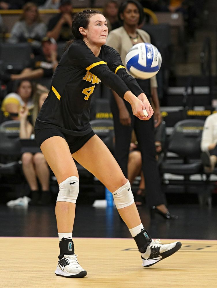 Iowa's Halle Johnston (4) eyes the ball during the fourth set of their volleyball match at Carver-Hawkeye Arena in Iowa City on Sunday, Oct 13, 2019. (Stephen Mally/hawkeyesports.com)