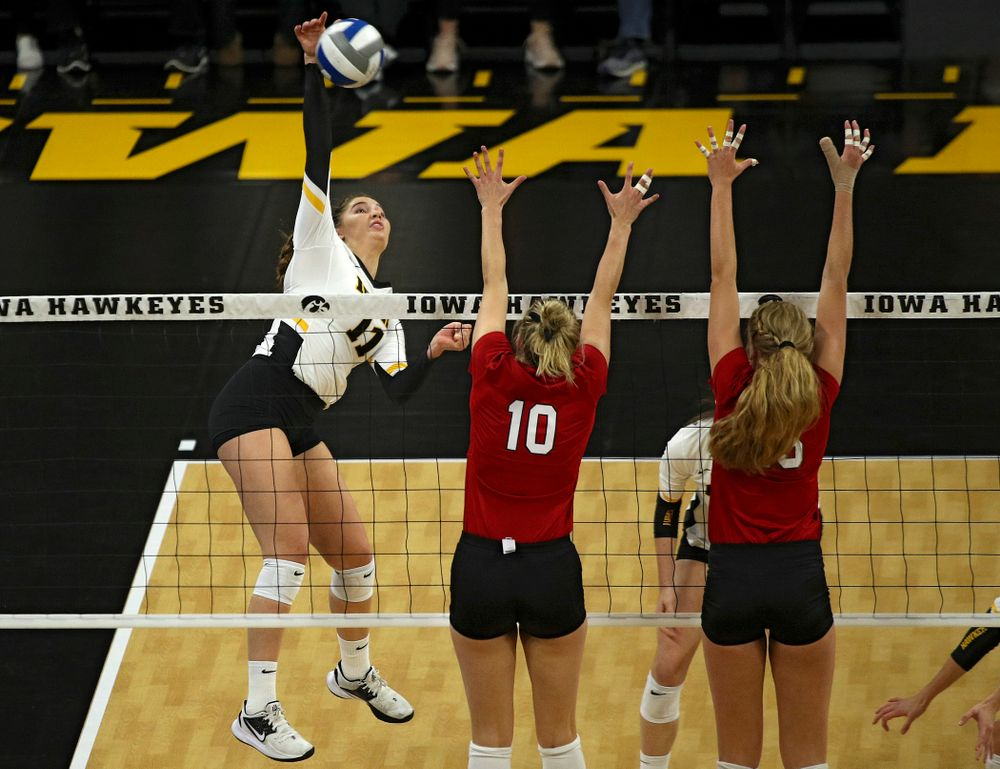 Iowa's Blythe Rients (11) goes up for a shot during the second set of their match against Nebraska at Carver-Hawkeye Arena in Iowa City on Saturday, Nov 9, 2019. (Stephen Mally/hawkeyesports.com)