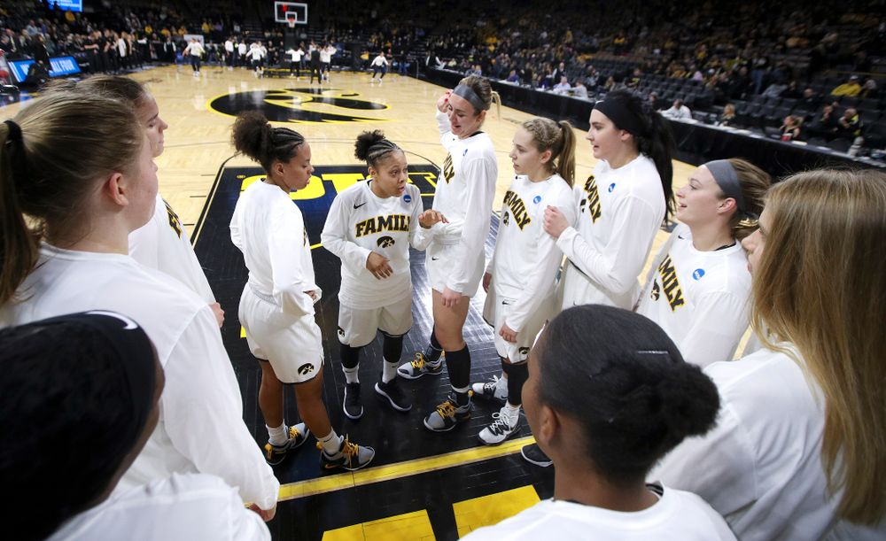 Iowa Hawkeyes guard Tania Davis (11) talks with her team before their second round game in the 2019 NCAA Women's Basketball Tournament at Carver Hawkeye Arena in Iowa City on Sunday, Mar. 24, 2019. (Stephen Mally for hawkeyesports.com)