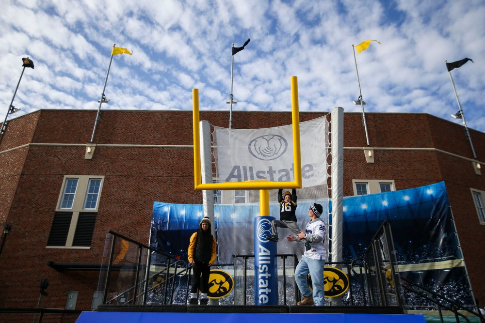 A child plays on a goalpost during Iowa football vs Penn State on Saturday, October 12, 2019 at Kinnick Stadium. (Lily Smith/hawkeyesports.com)