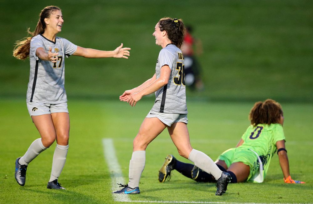 Iowa defender Hannah Drkulec (17) celebrates with forward Devin Burns (30) after Burns scored a goal during the first half of their match at the Iowa Soccer Complex in Iowa City on Friday, Sep 13, 2019. (Stephen Mally/hawkeyesports.com)