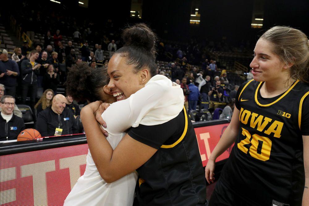 Iowa Hawkeyes guard Alexis Sevillian (5) hugs former Hawkeye and Clemson graduate assistant Tania Davis following their game Wednesday, December 4, 2019 at Carver-Hawkeye Arena. (Brian Ray/hawkeyesports.com)