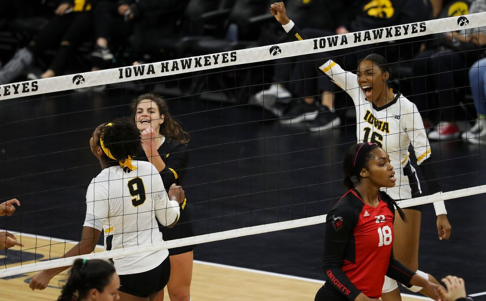 Iowa Hawkeyes outside hitter Taylor Louis (16) celebrates after winning a point during a match against Rutgers at Carver-Hawkeye Arena on November 2, 2018. (Tork Mason/hawkeyesports.com)