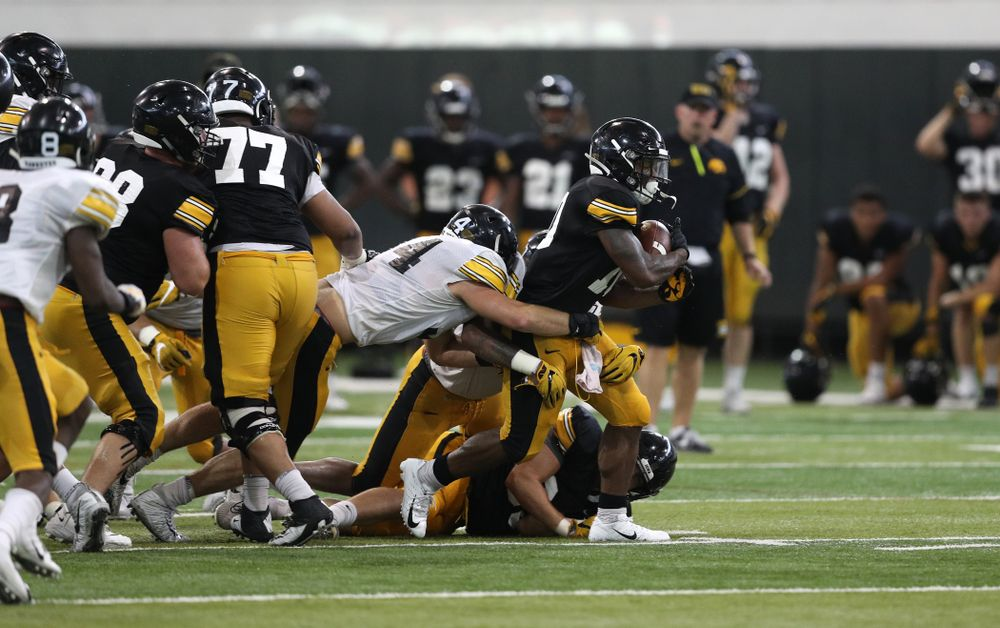 Iowa Hawkeyes running back Mekhi Sargent (10) and linebacker Kristian Welch (34) During Fall Camp Practice No. 6 Thursday, August 8, 2019 at the Ronald D. and Margaret L. Kenyon Football Practice Facility. (Brian Ray/hawkeyesports.com)