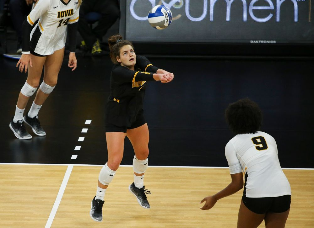 Iowa Hawkeyes defensive specialist Molly Kelly (1) bumps the ball during a game against Purdue at Carver-Hawkeye Arena on October 13, 2018. (Tork Mason/hawkeyesports.com)