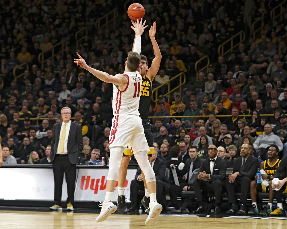 Iowa Hawkeyes center Luka Garza (55) makes a 3-pointer during the second half of their game at Carver-Hawkeye Arena in Iowa City on Monday, January 27, 2020. (Stephen Mally/hawkeyesports.com)