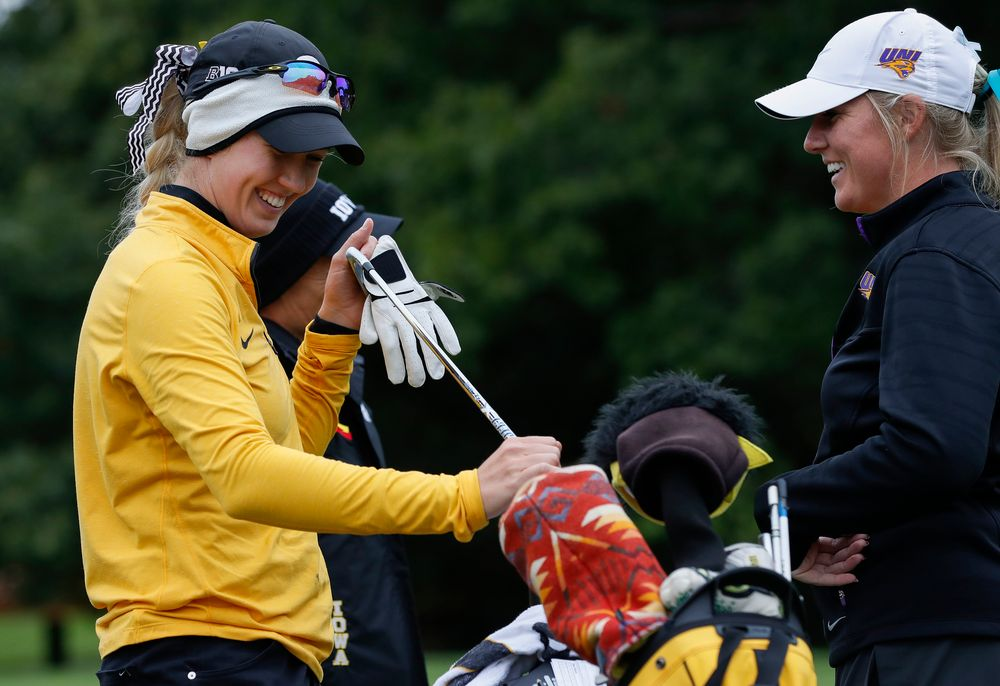 Iowa's Shawn Rennegarbe shares a laugh with former teammate and current Northern Iowa assistant coach Jessie Sindlinger at the eighth tee during the Diane Thomason Invitational at Finkbine Golf Course on September 29, 2018. (Tork Mason/hawkeyesports.com)