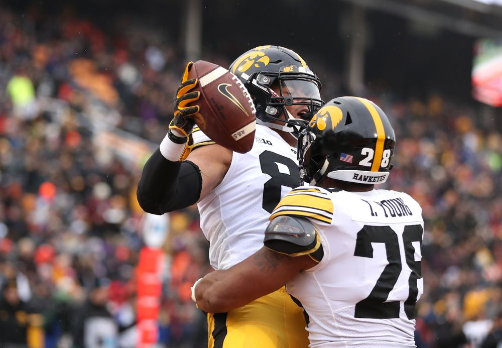 Iowa Hawkeyes tight end Noah Fant (87) and running back Toren Young (28) against the Illinois Fighting Illini Saturday, November 17, 2018 at Memorial Stadium in Champaign, Ill. (Brian Ray/hawkeyesports.com)