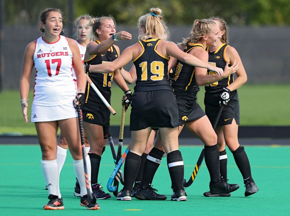 Iowa's Leah Zellner (13) celebrates with teammates after scoring a goal during the third quarter of their match at Grant Field in Iowa City on Friday, Oct 4, 2019. (Stephen Mally/hawkeyesports.com)