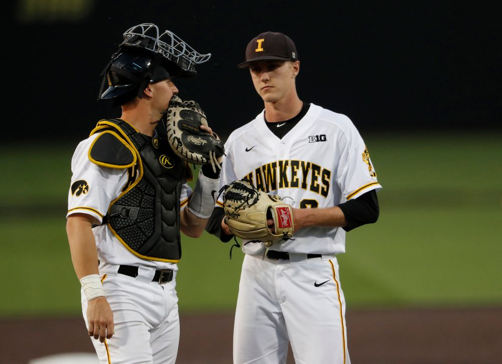 Iowa Hawkeyes catcher Tyler Cropley (5) and pitcher Zach Daniels (2) against the Penn State Nittany Lions  Thursday, May 17, 2018 at Duane Banks Field. (Brian Ray/hawkeyesports.com)
