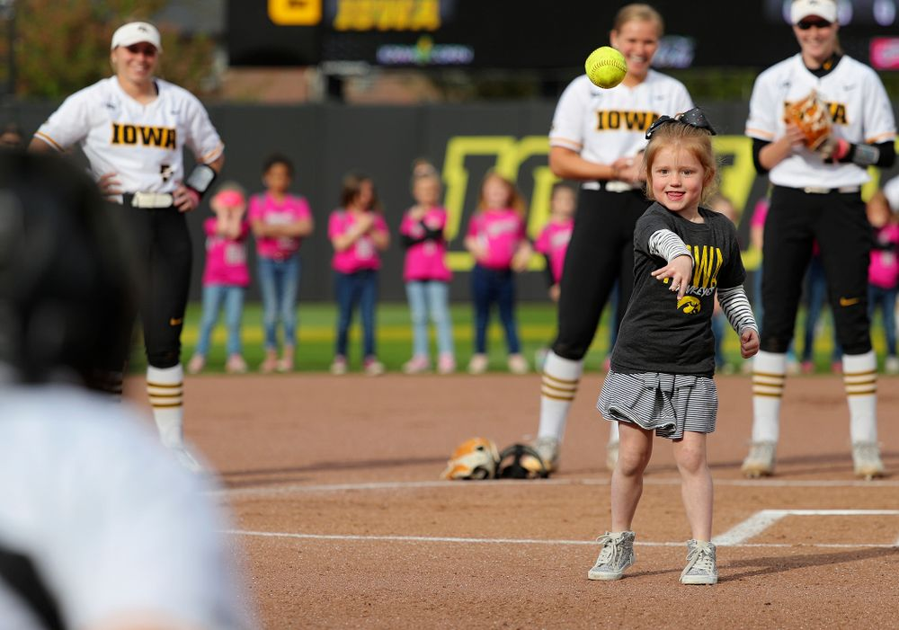 A young fan throws out the first pitch before the game against Ohio State at Pearl Field in Iowa City on Friday, May. 3, 2019. (Stephen Mally/hawkeyesports.com)